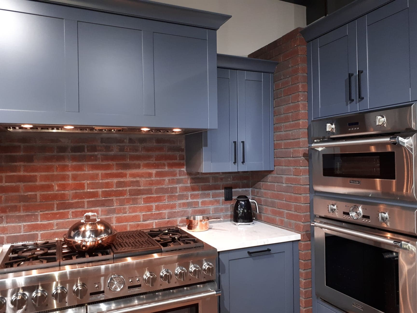 avenue appliance brick and blue kitchen