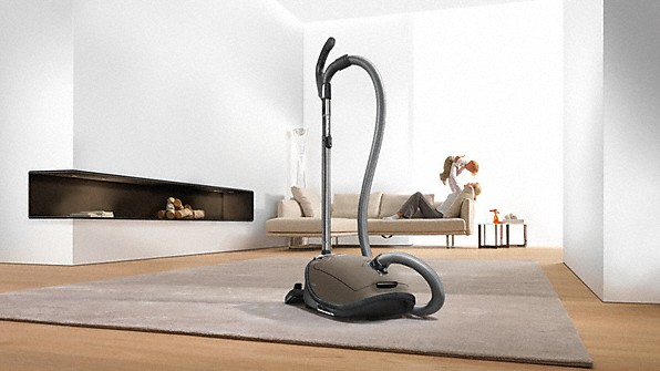 white living room with vacuum cleaner